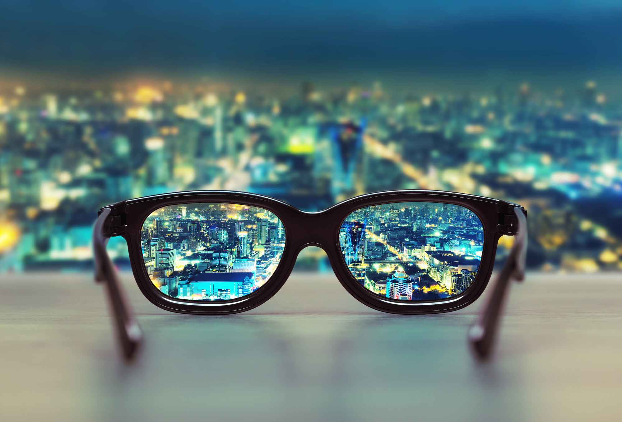 City at night through glasses