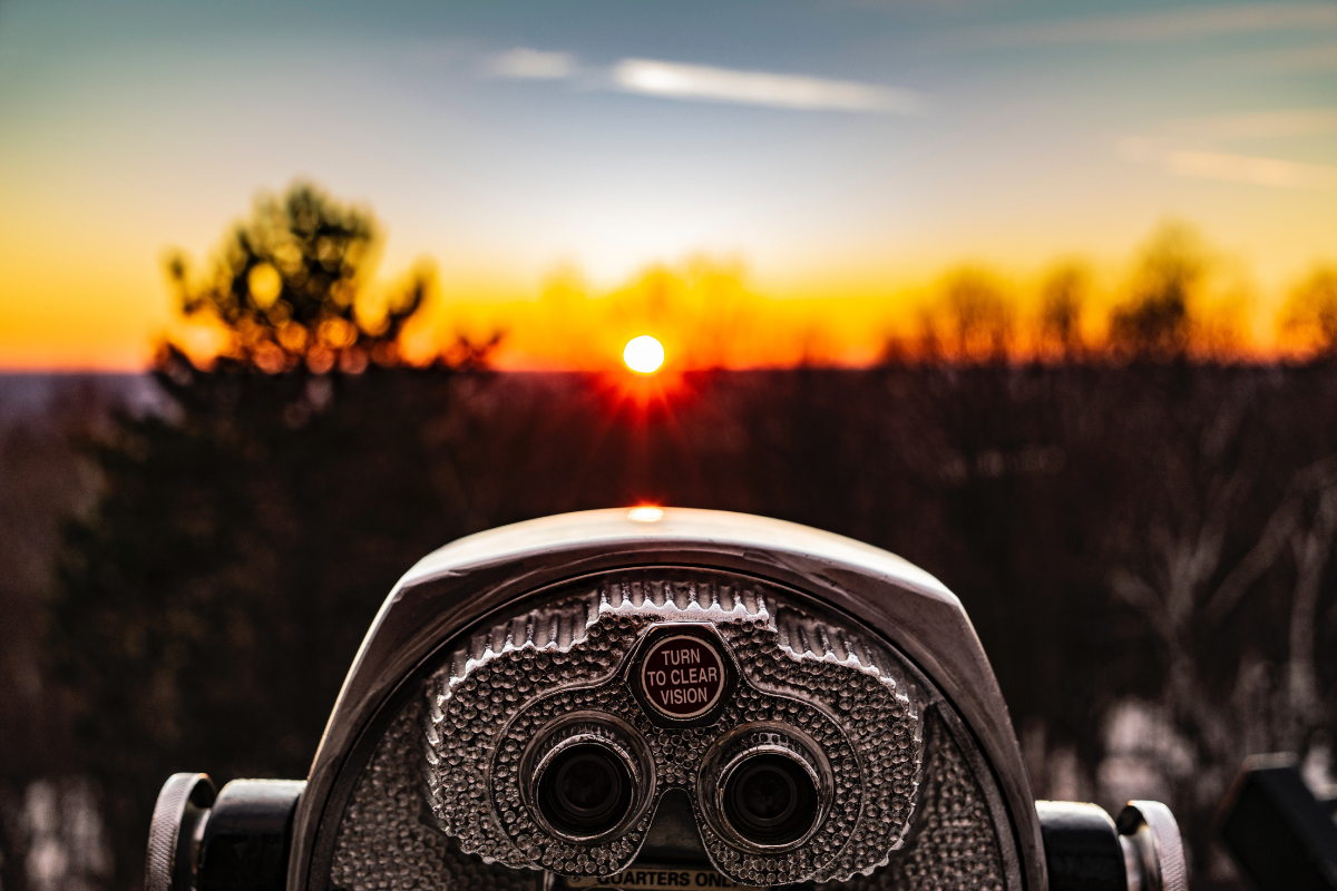 Landscape view of a sunset with a viewer in the front focus