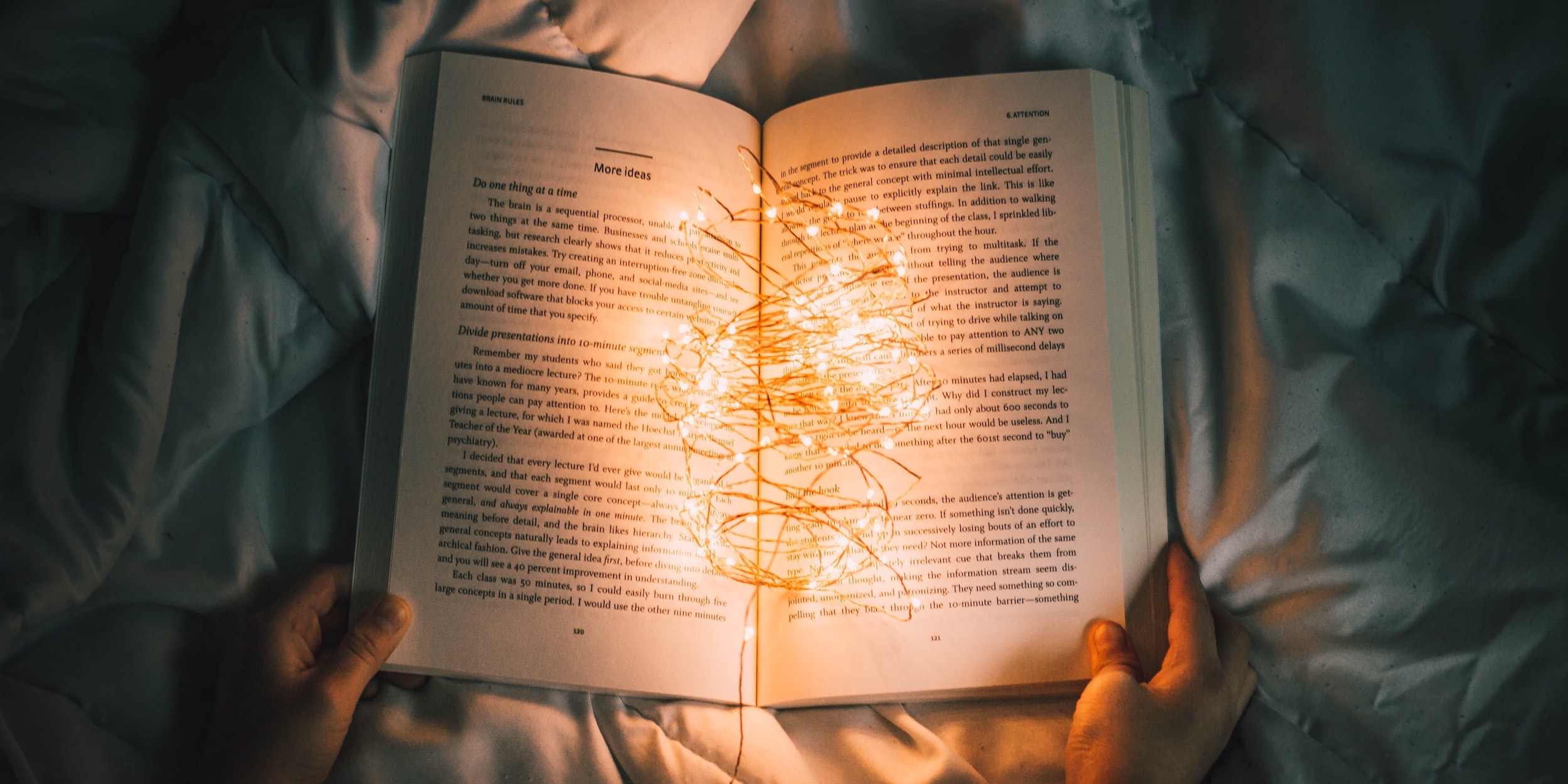 An open book with fairy lights